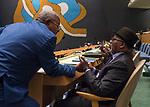 72 General Debate – 20 September <br /> <br /> 2 delegates speaking with each other at GA floor