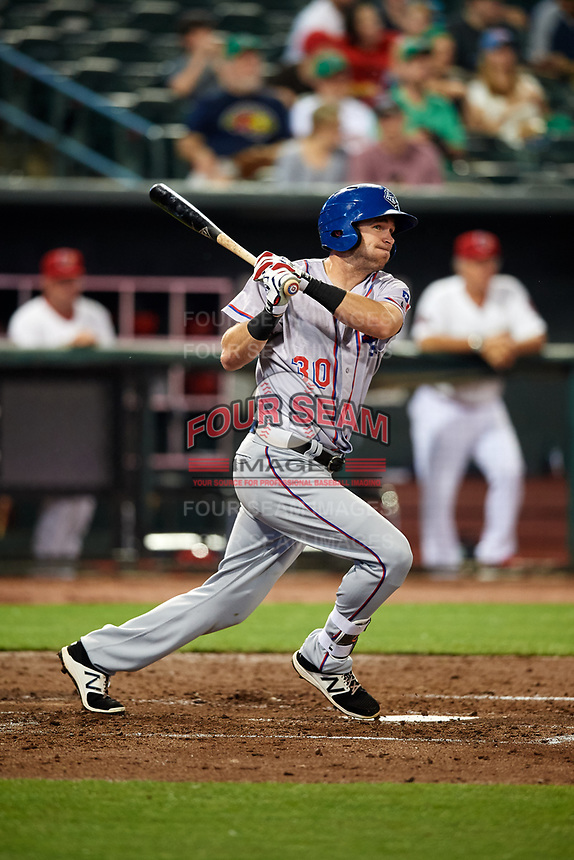 Round Rock Express right fielder Jared Hoying (30) follows through on a swing during a game against the Memphis Redbirds on April 28, 2017 at AutoZone Park in Memphis, Tennessee.  Memphis defeated Round Rock 9-1.  (Mike Janes/Four Seam Images)