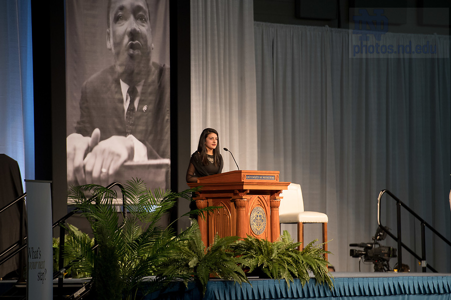 January 22, 2018; Hosnia Samadi, president of the Muslim Student Association, reads from the Quran at the 2018 MLK Luncheon. (Photo by Matt Cashore/University of Notre Dame)