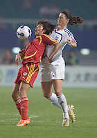 China's Duan Han chests the ball in front of World Stars' Cheryl Salisbury. The FIFA Women's World Stars played an exhibition match against China at the Wuhan Sports Center Stadium as part of the Women's World Cup Draw on April 21, 2007.