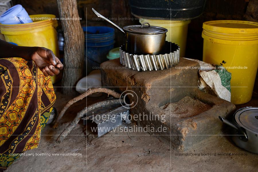 ZAMBIA, Sinazongwe, village Mweezya, woman cooks with energy saving firewood stove also called rocket stove