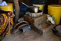 ZAMBIA, Sinazongwe, village Mweezya, woman cooks with energy saving firewood stove also called rocket stove