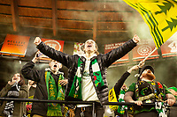 PORTLAND, OR - MARCH 01: A Timbers Army fan celebrates after the Portland Timbers scored a goal during a game between Minnesota United FC and Portland Timbers at Providence Park on March 01, 2020 in Portland, Oregon.