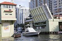 Ft. Lauderdale, Florida.  Pleasure Boat Passing under the SE 3rd. Avenue Drawbridge on New River.