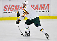 2 December 2011: University of Vermont Catamount defenseman Nick Bruneteau, a Sophomore from Omaha, NB, snaps a wrist shot against the University of Maine Black Bears at Gutterson Fieldhouse in Burlington, Vermont. The Catamounts fell to the Black Bears 6-4 in the first game of their 2-game Hockey East weekend series. Mandatory Credit: Ed Wolfstein Photo