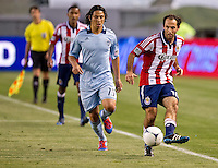 CARSON, CA - April 1, 2012: Roger Espinoza (15) of KC and Nick LaBrocca (10) of Chivas during the Chivas USA vs Sporting KC match at the Home Depot Center in Carson, California. Final score Sporting KC 1, Chivas USA 0.