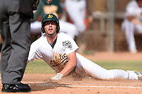 Oakland Athletics outfielder J.P. Sportman (28) looks to the umpire for a call after a play at the plate during an Instructional League game against the San Francisco Giants on October 15, 2014 at Papago Park Baseball Complex in Phoenix, Arizona.  (Mike Janes/Four Seam Images)