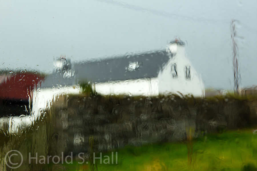 Looking at the house of the next door through our window pane on one of the many rainy days in Northern Ireland.