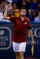 Giles Simon celebrates his win during the Legg Mason Tennis Classic at the William H.G. FitzGerald Tennis Center in Washington, DC.  Giles Simon defeated Andy Roddick in straight sets in a thunderstorm delayed evening session.