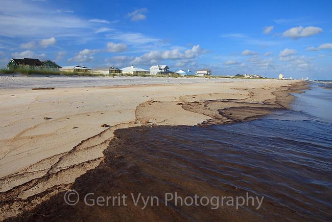 Black oil washing ashore from the BP Deepwater Horizon oil leak. Baldwin County, Alabama. June 2010.