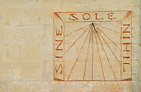 The sun dial on the wall of the building with the carved stone inscription 'Sine Sole Nihil', without the sun there is nothing. Chateau Mourgues du Gres Grès, Costieres de Nimes, Bouches du Rhone, Provence, France, Europe