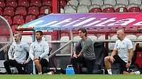 Brentford Manager, Thomas Frank takes a knee alongside his coaching staff ahead of kick-off during Brentford vs Preston North End, Sky Bet EFL Championship Football at Griffin Park on 15th July 2020