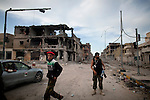 Revolutionaries in Sirte, Libya, the day after Col. Muammar Gaddafi was captured and killed, Oct. 21, 2011.