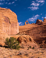 Delicate Arch perched on sandstone cliff, Arches National Park, Utah.