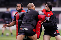 Paulos LATU (30) of London Broncos (centre) warms up ahead of the Betfred Challenge Cup Round One match between London Broncos and Keighley Cougars at The Rock, Rosslyn Park, London, England on 20 March 2021. Photo by David Horn.