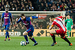 Lionel Andres Messi of FC Barcelona (L) fights for the ball with Alex Granell Nogue of Girona FC (R) in action during the La Liga 2017-18 match between FC Barcelona and Girona FC at Camp Nou on 24 February 2018 in Barcelona, Spain. Photo by Vicens Gimenez / Power Sport Images