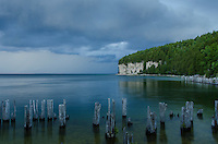 Storm clouds moving over Lake Michigan and the limestone cliffs at Fayette Historic State Park.