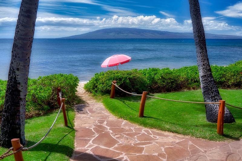 Path to beach with beach umbrella. Mauai, Hawaii