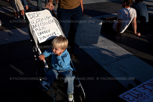 Washington, DC.October 6, 2011..A mother and son bring their message to Freedom Square.