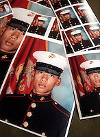 SF.Marines.#79.db.09-28... Marine recruit Victor Rustandi (cq) got his pictures back just one day before graduation that were taken earlier in the month which are his official Marine portraits. Photo by David Bohrer/FTT.