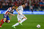 Atletico de Madrid's Siqueira and Real Madrid´s Gareth Bale during quarterfinal first leg Champions League soccer match at Vicente Calderon stadium in Madrid, Spain. April 14, 2015. (ALTERPHOTOS/Victor Blanco)