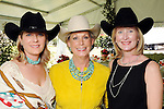 From left:Miriam Westmoreland, Paula Robinson and Kelly Hancock at the Hermann Park Conservancy Hat Party Tuesday March 9,2010. (Dave Rossman Photo)