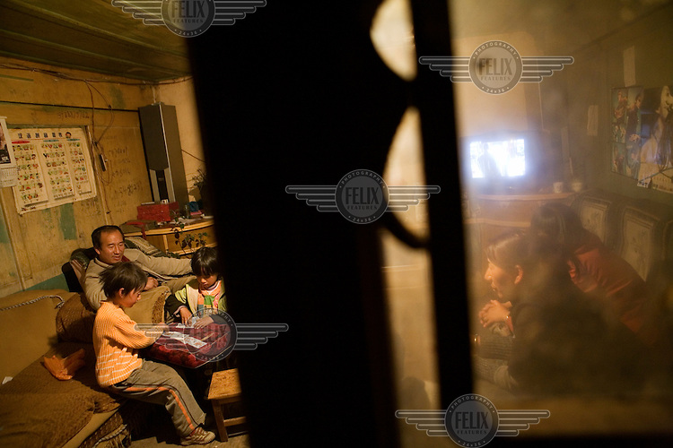 A Nakhi (Naxi) family at home in the town of Lu Dian on the outskirts of Lijiang county.