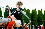 BEACON FALLS, CT-112020JS15—Marissa O'Rourke, one the senior captains of the Woodland Timber Team, competes in the cross cut competition during the Battle Royal Friday at Woodland Regional High School.<br />  Jim Shannon Republican-American