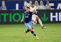 CARSON, CA - OCTOBER 18: Lucas Cavallini #9 of the Vancouver Whitecaps and Daniel Steres #5 of the Los Angeles Galaxy battle for a ball during a game between Vancouver Whitecaps and Los Angeles Galaxy at Dignity Heath Sports Park on October 18, 2020 in Carson, California.