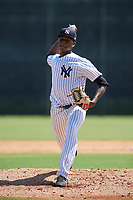 GCL Yankees East starting pitcher Elvis Peguero (61) delivers a pitch during a game against the GCL Blue Jays on August 2, 2018 at Yankee Complex in Tampa, Florida.  GCL Yankees East defeated GCL Blue Jays 5-4.  (Mike Janes/Four Seam Images)