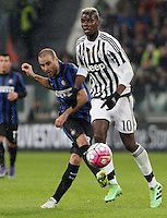 Calcio, Serie A: Juventus vs Inter. Torino, Juventus Stadium, 28 February 2016.<br /> Inter's Rodrigo Palacio, left, is challenged by Juventus' Paul Pogba during the Italian Serie A football match between Juventus and Inter at Turin's Juventus Stadium, 28 February 2016.<br /> UPDATE IMAGES PRESS/Isabella Bonotto