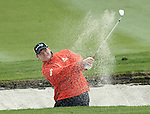 SUZHOU, CHINA - APRIL 15:  Paul Lawrie of Scotland plays a bunker shot on the 10th hole during the Round One of the Volvo China Open on April 15, 2010 in Suzhou, China. Photo by Victor Fraile / The Power of Sport Images