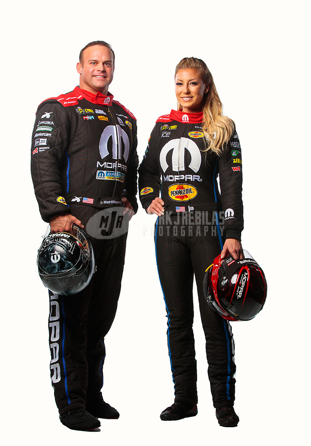 Feb 6, 2019; Pomona, CA, USA; NHRA funny car driver Matt Hagan (left) and top fuel driver Leah Pritchett pose for a portrait during NHRA Media Day at the NHRA Museum. Mandatory Credit: Mark J. Rebilas-USA TODAY Sports
