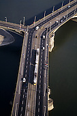 Budapest, Hungary. Aerial view of Margit (Margaret) Bridge where it touches Margit Island with traffic and a tram.