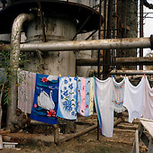 Baku, Azerbaijan .December 14, 2006..Just a few meters from the British Petroleum's massive off-shore platform being built on shore, is one of the poorest districts near Baku - Bibi Heybat. Most of the residents are refugees from Nagorno-Karabakh region settled here during the war...In this former Soviet Gas factory nearly 300 people live.