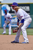 Taylor Davis (19) of the Iowa Cubs takes his defensive stance at first base against the New Orleans Zephyrs at Principal Park on April 23, 2015 in Des Moines, Iowa.  The Zephyrs won 9-2.  (Dennis Hubbard/Four Seam Images)