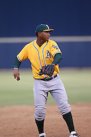 Miguel Mercedes (15) of the AZL Athletics at third base during a game against the AZL Brewers at Maryvale Baseball Park on June 30, 2015 in Phoenix, Arizona. Brewers defeated Athletics, 4-2. (Larry Goren/Four Seam Images)
