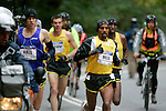 Meb Keflezighi leads the front pack through Central Park in the 2008 Men's Olympic Trials Marathon on November 3, 2007 in New York, New York.  The race began at 50th Street and Fifth Avenue and finished in Central Park.  Ryan Hall won the race with a time of 2:09:02.