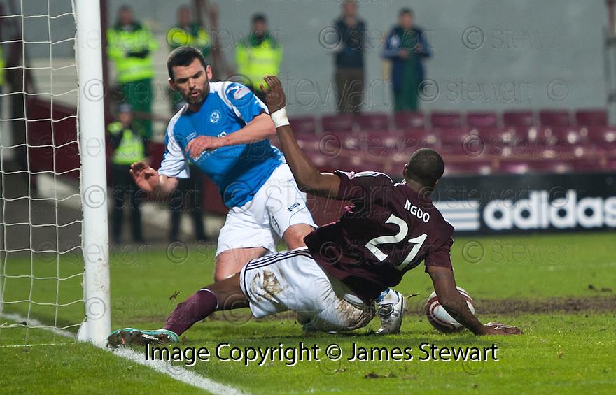 St Johnstone's Callum Davidson gets back to block Hearts' Michael Ngoo on the line.