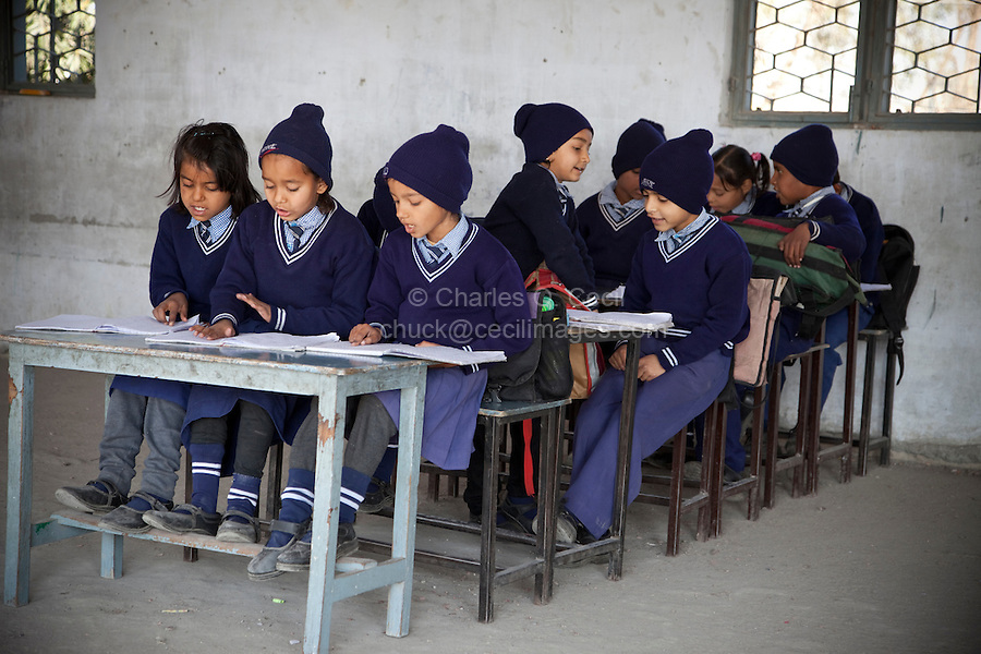 Madrasa Students, Madrasa Islamia Arabia Izharul-Uloom, Dehradun, India.  In addition to Koranic studies these students learn other subjects needed for a well-rounded primary school education.