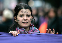 """Manifestazione nazionale contro la violenza maschile sulle donne, a Roma, 22 novembre 2008..A girl has his face painted with a slogan reading """"I am mine. Neither fathers, nor owners, nor husbands"""" during a national rally against male violence on women in Rome, 22 november 2008..UPDATE IMAGES PRESS/Riccardo De Luca"""
