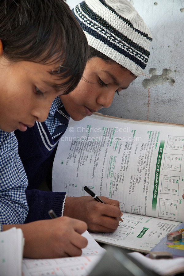 Madrasa Students Doing their Mathematics Lesson, Madrasa Islamia Arabia Izharul-Uloom, Dehradun, India.