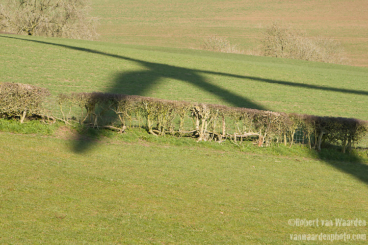The shadow of the St. Briavels wind turbine on the green pastures of St. Briavels.