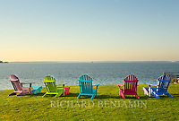 Some colorful Adirondack chairs look out at Conimicut Light.