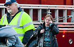 MIDDLEBURY,  CT-122716JS08-- Anna Weber, a resident at the two -family home at 165 Whittemore Road in MIddlebury talks on the phone as firefighters battle a fatal fire at the home on Tuesday. <br /> Jim Shannon