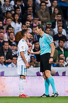 Lucas Vazquez of Real Madrid speaks with referee Juan Martinez Munuera during the La Liga 2017-18 match between Real Madrid and Athletic Club Bilbao at Estadio Santiago Bernabeu on April 18 2018 in Madrid, Spain. Photo by Diego Souto / Power Sport Images