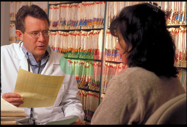 doctor confers with patient