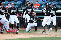 April 10, 2010:  Hector Gimenez (23 - kneeling), Gorkys Hernandez (43), Matt Hague (behind Gimenez), Chase d'Arnaud (far back) Jordy Mercer(14), Miles Durham (28) of the Altoona Curve celebrate as Josh Harrison scores the winning run in the 10th inning during a game at Blair County Ballpark in Altoona, PA.  Photo By Mike Janes/Four Seam Images