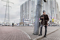 Dmitry Musolin Ph.D. Checking his phone near a bus station. He is a gay activist and Associate Professor of the Department of Forest Protection and Game Management & Director of the Department of Advanced Training and Graduate Studies. (MANDATORY CREDIT   photo: Mads Nissen/Panos Pictures /Felix Features)