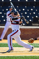 Colin Hawk (2) of the Cincinnati Bearcats follows through on his swing against the Radford Highlanders at Wake Forest Baseball Park on February 22, 2014 in Winston-Salem, North Carolina.  The Highlanders defeated the Bearcats 6-5.  (Brian Westerholt/Four Seam Images)